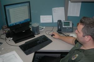 officer sitting at computer