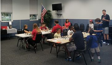groups of people playing chess